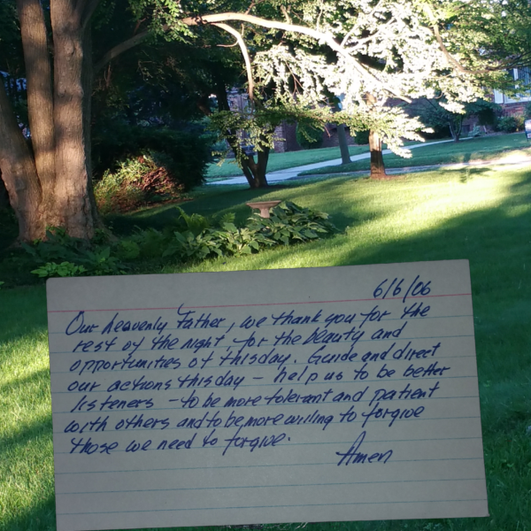 index card prayer superimposed on view of yard